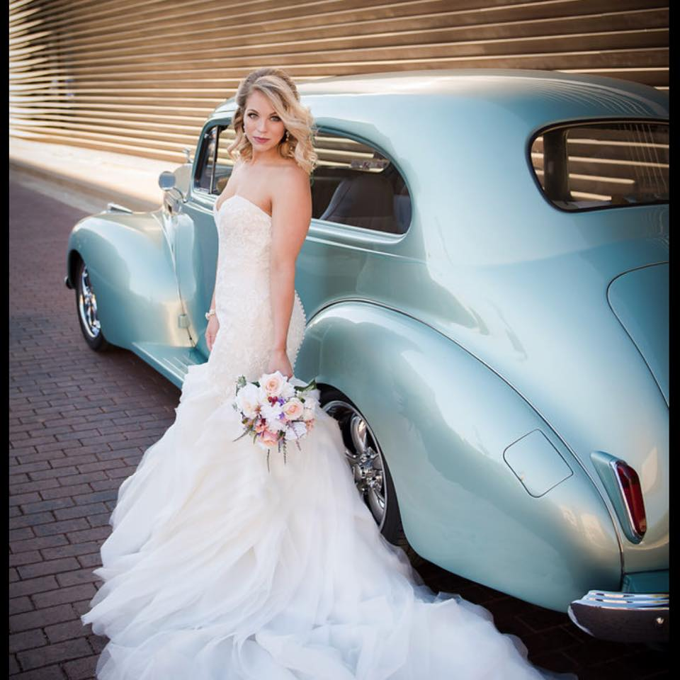 Azarue's Bridal Salon - Woman Standing next to car in wedding dress
